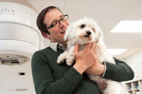 Doctor holding white dog