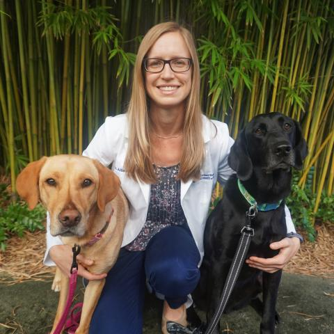 Allison O'Kell with her dogs.