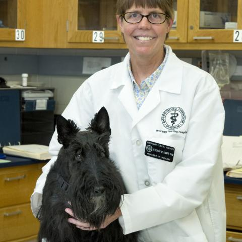 Photo of Debbie Knapp and a Scottish Terrier